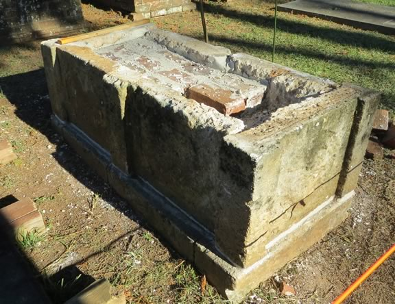Box grave as it is being repaired